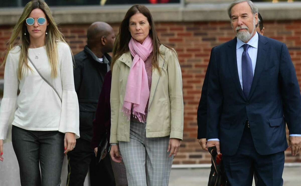 Michelle Troconis, center, arrives at the Stamford courthouse Friday morning for a pre-trial hearing on tampering with evidence and hindering prosecution charges in Jennifer Dulos' disappearance.