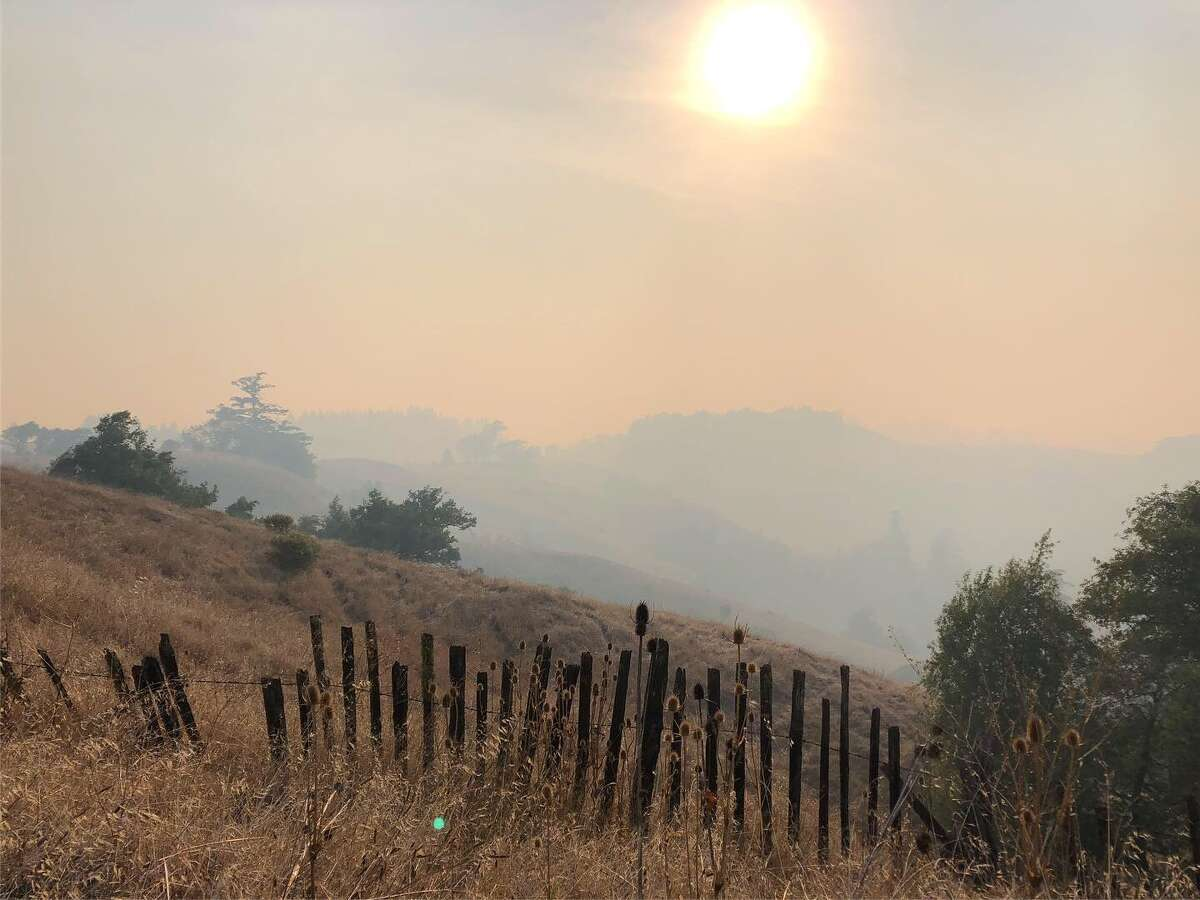 On the coast an hour from Geyserville, Fort Ross was blanketed in smoke with the Kincade Fire burning an hour-drive away.