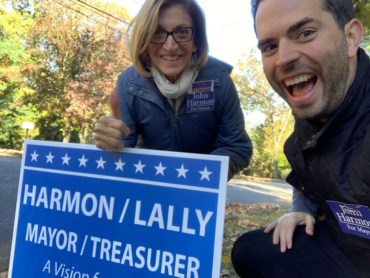 John Harmon's wife, Clara, and his son-in-law, Shawn, made the campaigning a family affair. Harmon, a Democrat, spent the weekend knocking on doors and placing signs as he continues his run for mayor against incumbent Republican Mark Lauretti.