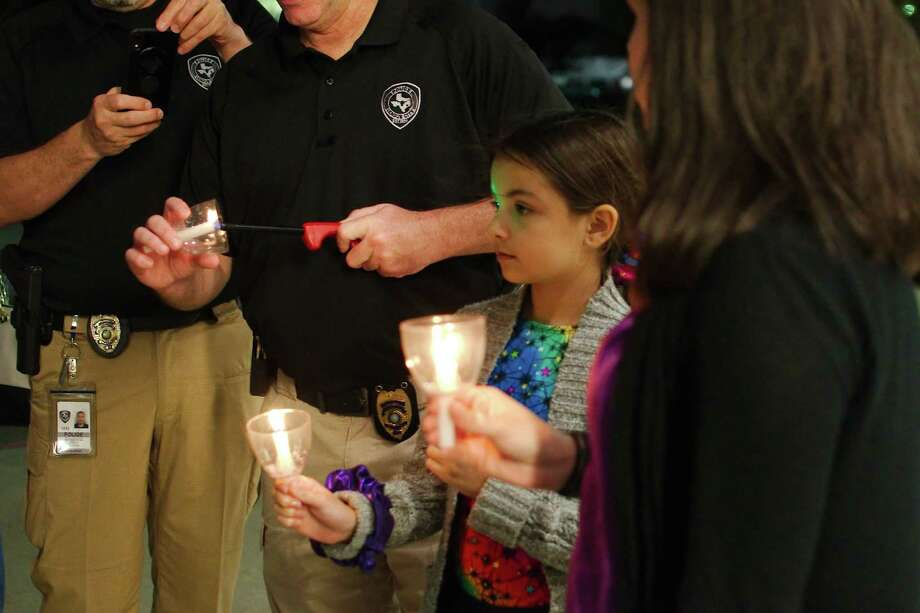 Marlo McGee participates in an Oct. 24 candlelight vigil to raise awareness of domestic violence outside the League City Public Safety Building. Photo: Kirk Sides / Staff Photographer / © 2019 Kirk Sides / Houston Chronicle