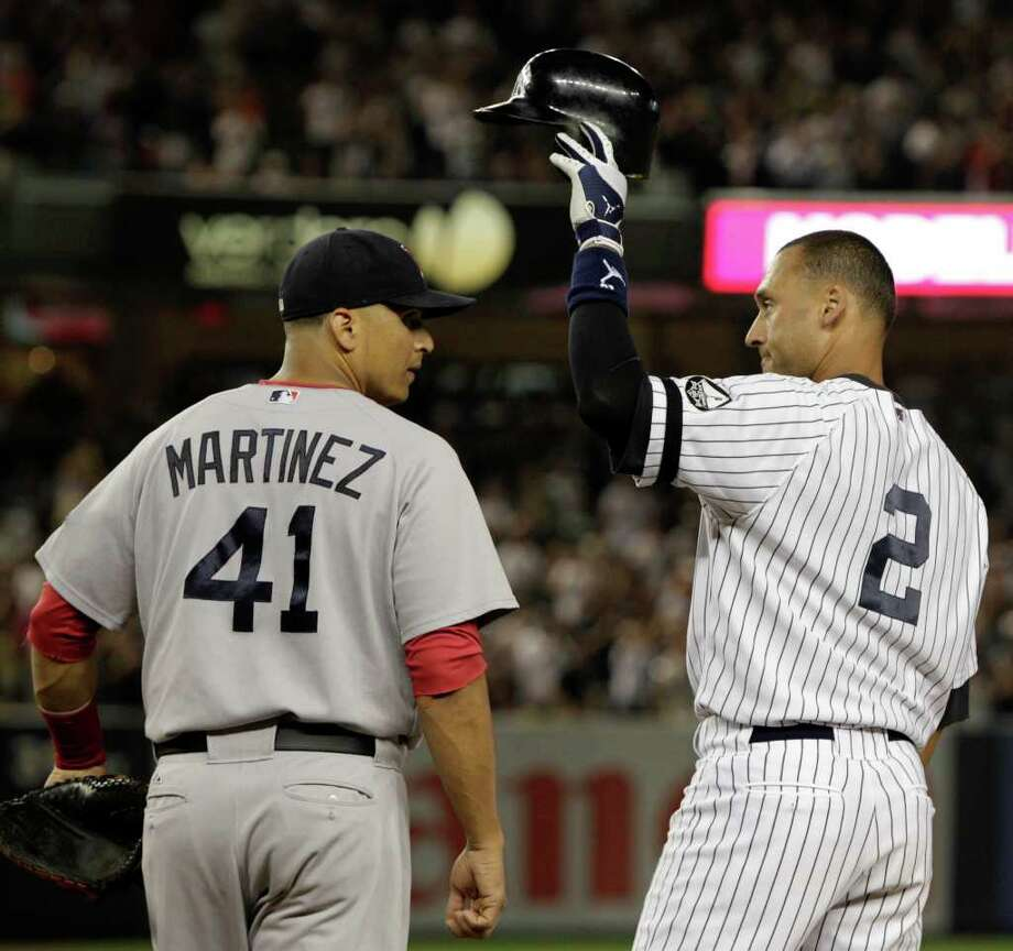 Boston Red Sox first baseman Victor Martinez (41) watches as New York Yankees Derek Jeter tips his cap to the crowd after hitting his 2,874th hit, a second-inning, RBI single, surpassing Babe Ruth on Major League Baseball's all time hits list, in their baseball game at Yankee Stadium on Sunday, Aug. 8, 2010 in New York. (AP Photo/Kathy Willens) Photo: AP