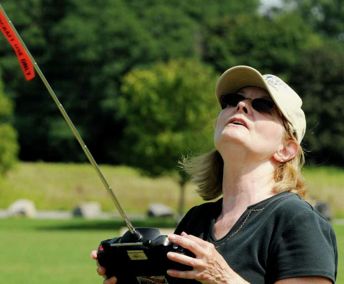 Sherrill McGill of Scotia operates one of her radio-controlled model airplanes at an event sponsored by Electric Powered Modelers at Maalwyck Park in Glenville on Sunday, Aug. 8, 2010. (Luanne M. Ferris / Times Union)