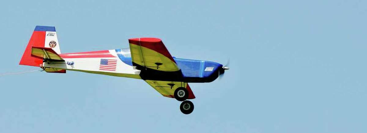 A radio-controlled model airplane flown by John Hackert of Rotterdam, president of the Electric Powered Modelers, at Maalwyck Park in Glenville on Sunday, Aug. 8, 2010. (Luanne M. Ferris / Times Union)