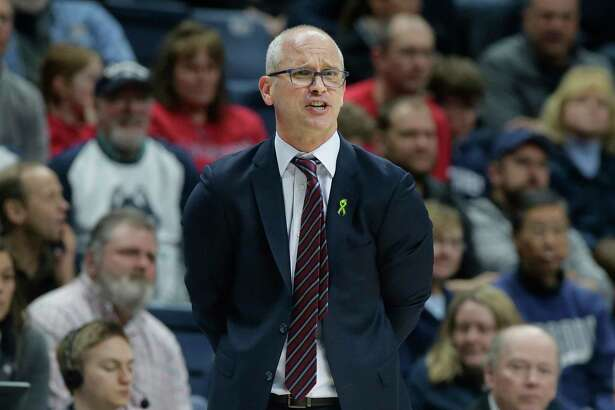 FILE - In this March 3, 2019, file photo, Connecticut head coach Dan Hurley shouts from the bench during the second half of an NCAA college basketball game against South Florida, in Storrs, Conn. Hurley expects UConn to be better this season, the second in the coach's effort to rebuild the storied program back to national prominence. That doesn't mean that Connecticut, which went 16-17 a year ago, will compete for a fifth national championship, but it should mean the Huskies will win more games than they lose. That's something UConn has not done since 2015-16.