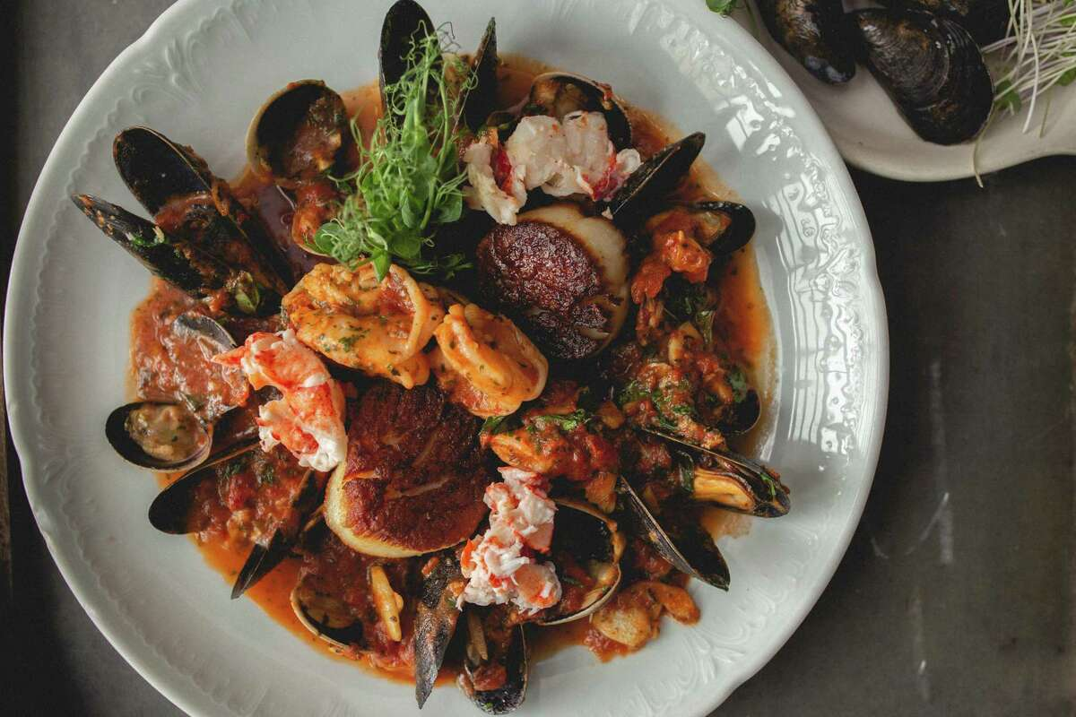 Bartolo's Tuscan stew is served in a large bowl full of jumbo prawns, scallops, lobster, Manila clams, mussels, in a gorgeous tomato basil broth with toasted focaccia to dip.
