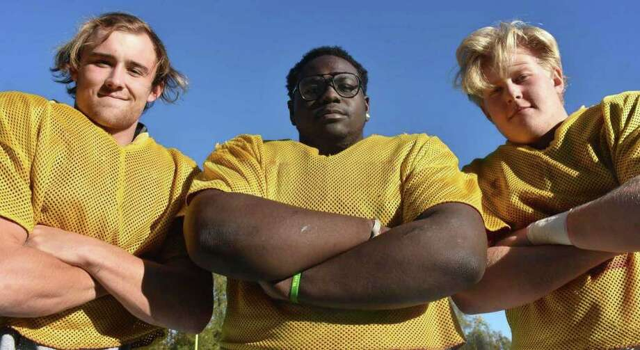 St. Joseph football's defensive line of Mike Morrissey, Jermaine Williams and Cayden Porter are anchoring the Hogs defense that has allowed just 9.6 points per game this season. Photo: Pete Paguaga / Hearst Connecticut Media / Trumbull Times