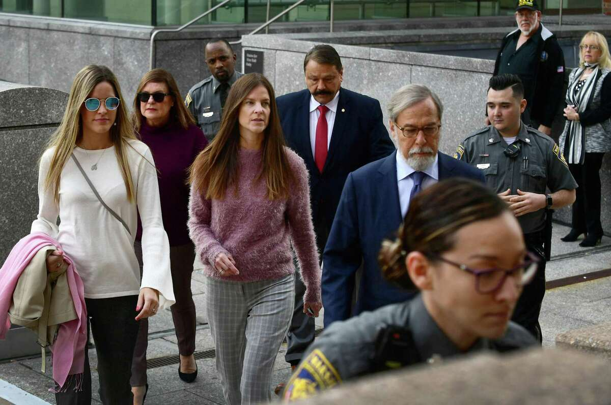 Michelle Troconis, center, charged with two counts of tampering with evidence and hindering prosecution in the disappearance of Jennifer Dulos, leaves the court after appearing for a pre-trial hearing with her mother, attorney, and sister on Friday, October 25, 2019, at the Stamford Superior Court in Stamford, Conn.