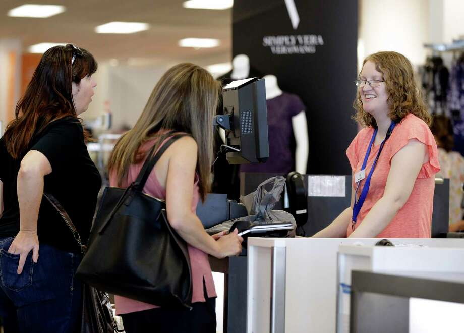 Cashier Liz Moore, right, checks out customers Christie Meeks, center, and Lisa Starnes, left, at a Kohl's store in Concord, N.C. Photo: Chuck Burton / Associated Press File / Copyright 2018 The Associated Press. All rights reserved