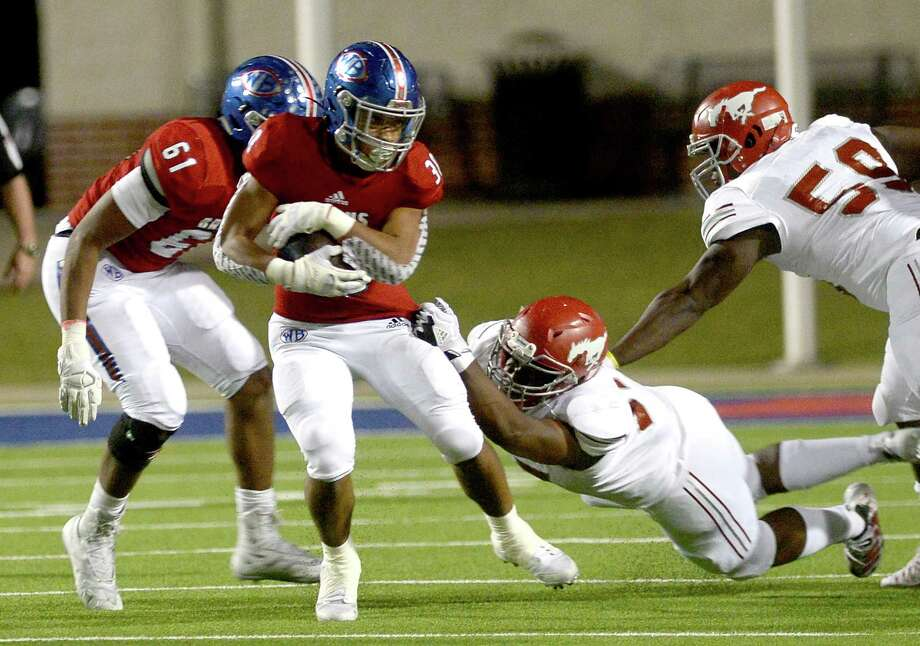 PHOTOS: Houston-area high school football coaches salaries in 2019  West Brook's Jordan Guidry tries to avoid North Shore's tackle during their match-up at BISD Memorial Stadium Thursday.  Photo taken Thursday, October 24, 2019 Kim Brent/The Enterprise  >>>See how much Houston's highest paid high school football coaches make ...  Photo: Kim Brent, The Enterprise / BEN