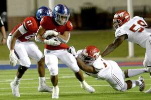 West Brook's Jordan Guidry tries to avoid North Shore's tackle during their match-up at BISD Memorial Stadium Thursday.  Photo taken Thursday, October 24, 2019 Kim Brent/The Enterprise