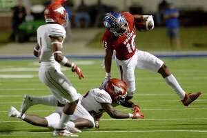 West Brook's Thaddeaus Johnson looks to evade North Shore's tackle during their match-up at BISD Memorial Stadium Thursday.  Photo taken Thursday, October 24, 2019 Kim Brent/The Enterprise