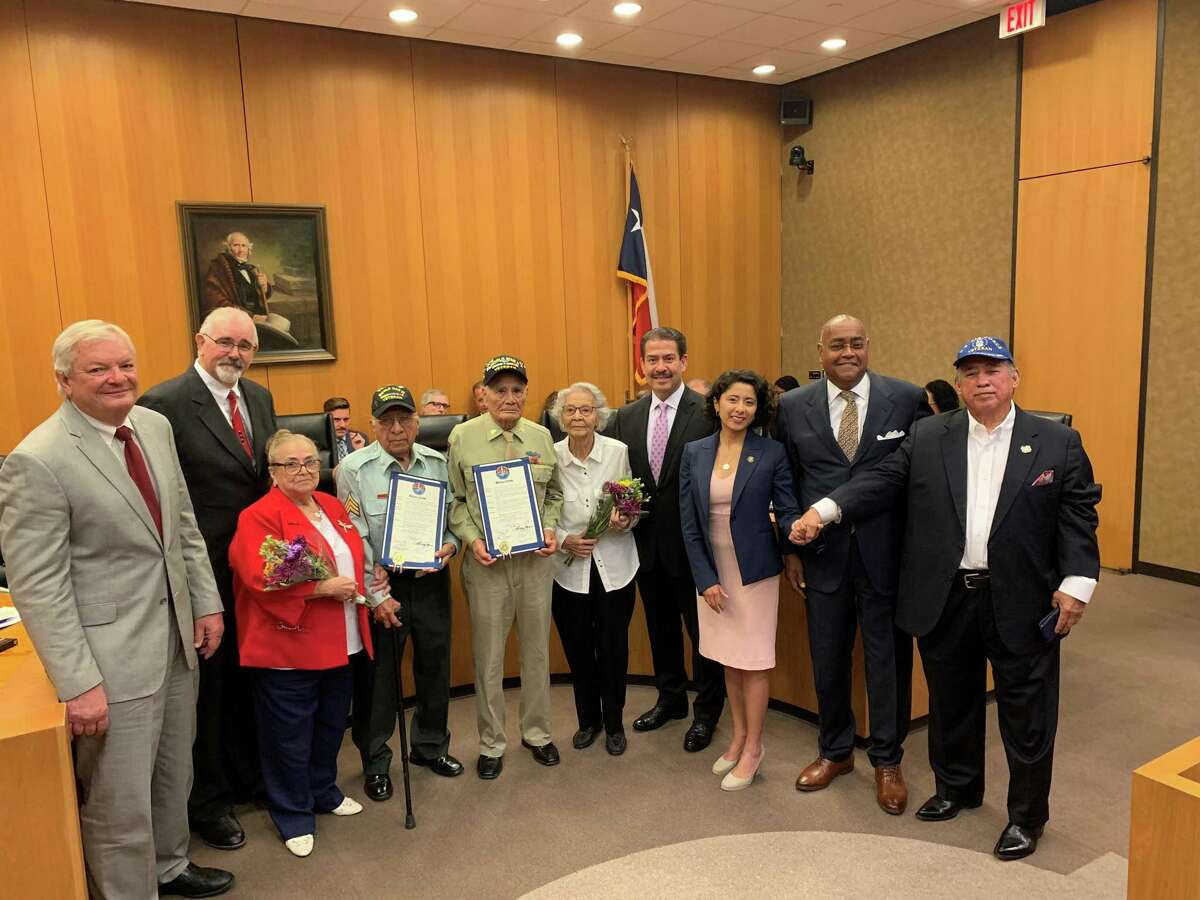 World War II veterans were honored this past August for their service. From left are Steve Radack, Jack Cagle, David Loredo and family, Vicente Moreno and family, Harris County Precinct 2 Commission Adrian Garcia, Harris County Judge Lina Hidalgo and Rodney Ellis, among others.