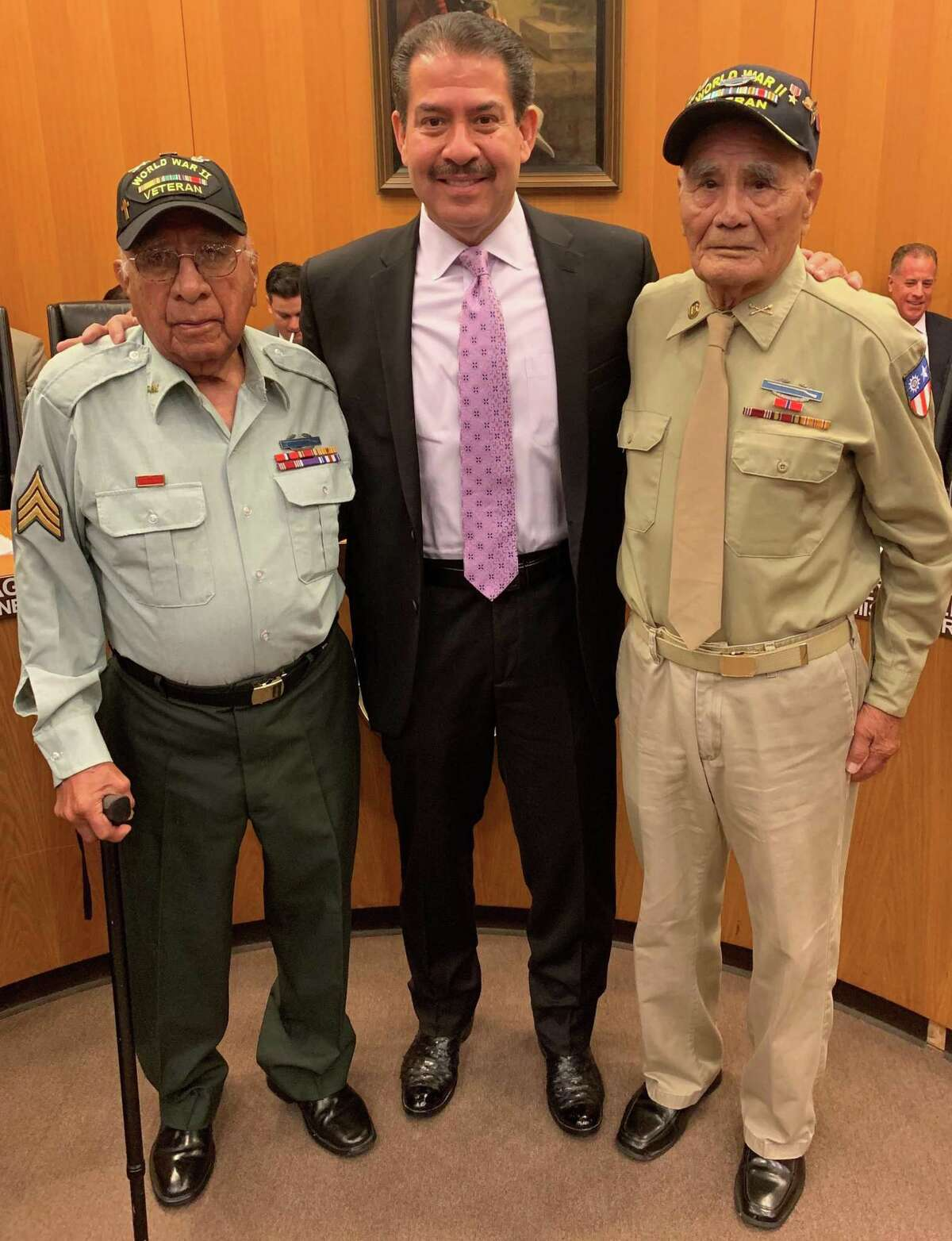 World War II veterans David Loredo, left, and Vicente Moreno were honored this past August for their service by Harris County Precinct 2 Commission Adrian Garcia.