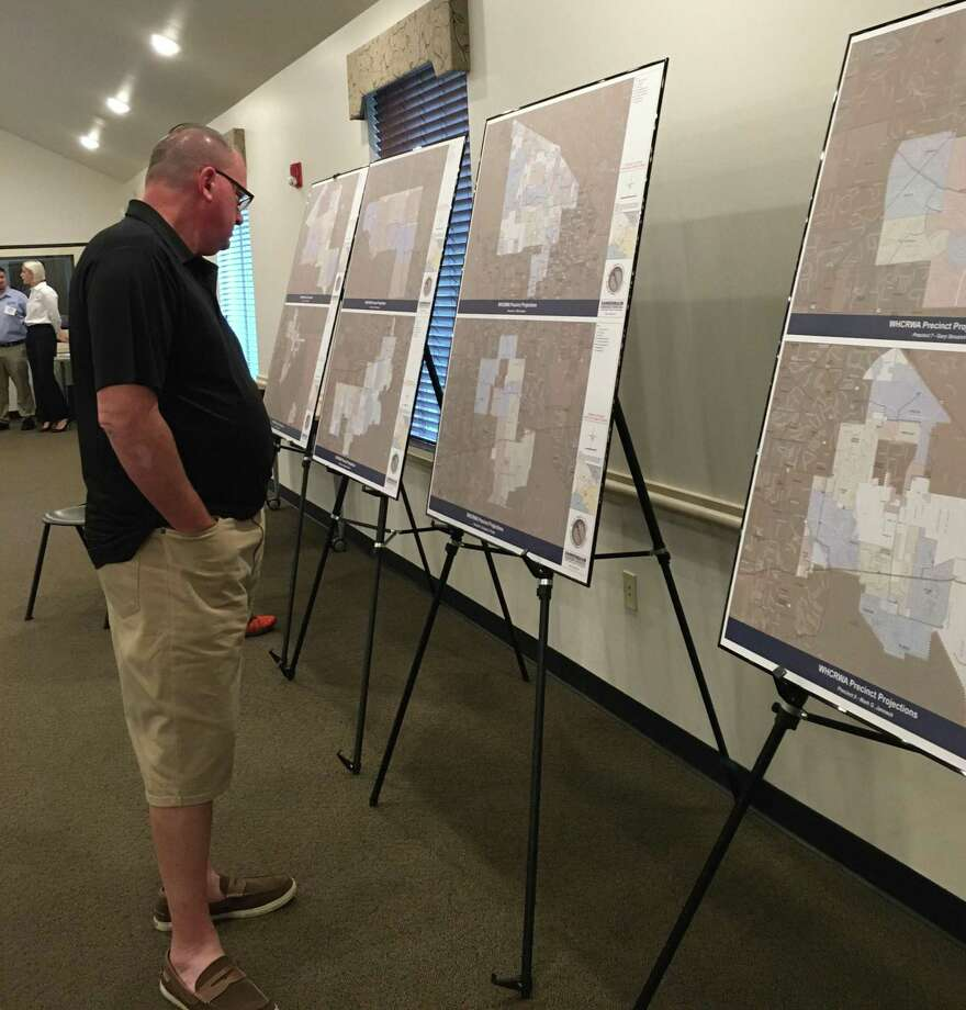 People attending the Oct. 23 town hall meeting of the West Harris County Regional Water Authority could check out maps displayed at the Fry Road Municipal Utility District Administration Building. Photo: Karen Zurawski / Karen Zurawski