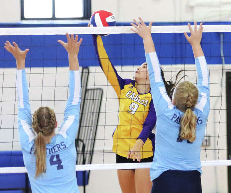 CM's Taylor Schwab (middle) tries to hit past the block put up by Jersey's Lauren Brown (left) and Lauren Rexing in an Oct. 1 match in Bethalto. The Eagles completed their Valley sweep of the Panthers with a two-set win Thursday night in Jerseyville. Photo: Greg Shashack / The Telegraph