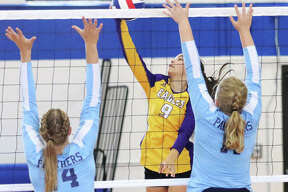 CM's Taylor Schwab (middle) tries to hit past the block put up by Jersey's Lauren Brown (left) and Lauren Rexing in an Oct. 1 match in Bethalto. The Eagles completed their Valley sweep of the Panthers with a two-set win Thursday night in Jerseyville.