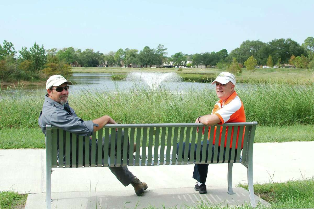 Exploration Green land steward and master naturalist George Kyame sits with Frank Weary next to the pond at at Exploration Green park phase I.