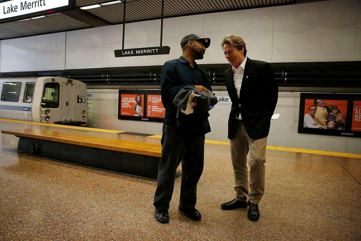 BART General Manager Robert Powers (right) talks with BART train operator Al Davillier (left) on the platform after Powers disembarked at Lake Merritt BART station on Monday, September 30, 2019 in Oakland, CA.