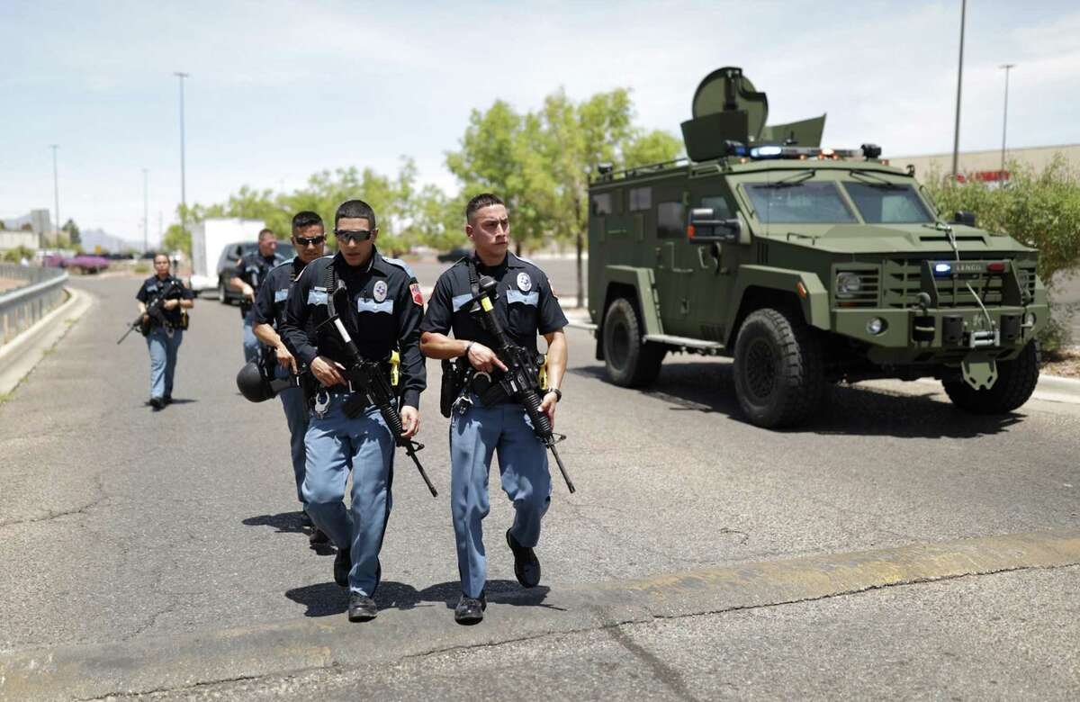 Local law enforcement respond to an active shooter situation near Cielo Vista Mall in El Paso, Texas. Despite the recent surge in gun violence committed by police, a reader says law enforcement should remain armed.