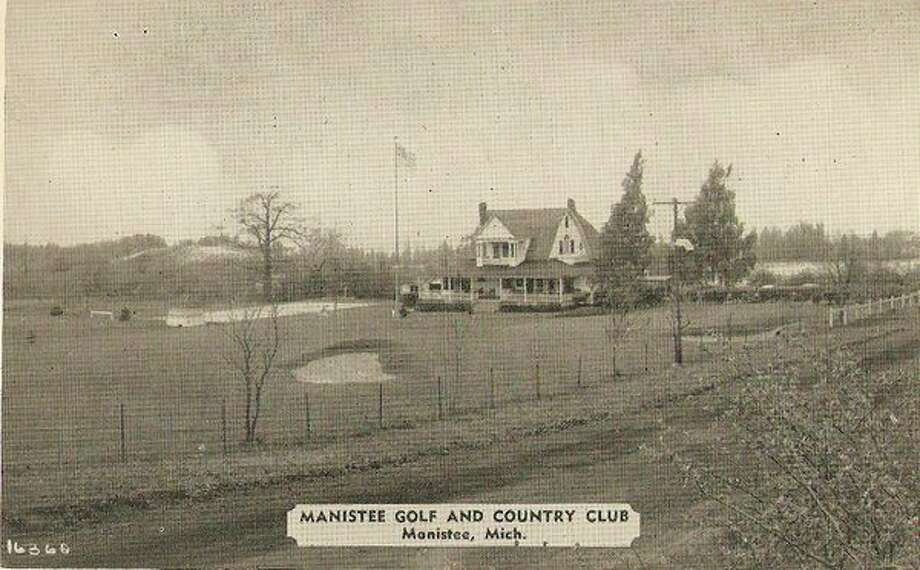 The Manistee Golf and Country Club is shown in this photo during the early 1900s when Cherry Road that runs in front of it wasn't even a paved road at that time.