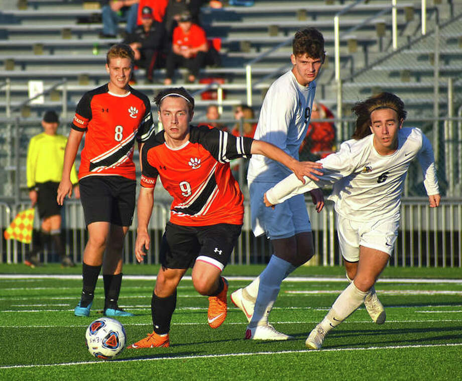 Edwardsville forward Cooper Nolan comes out of a pile-up with possession during a game against Granite City in Edwardsville. Photo: Matt Kamp|The Intelligencer