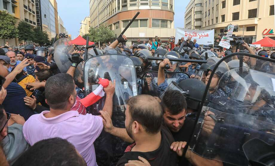 Security forces clash with supporters of the Hezbollah movement during a demonstration in the capital Beirut on the ninth day of protests against tax increases and official corruption. Photo: AFP Via Getty Images