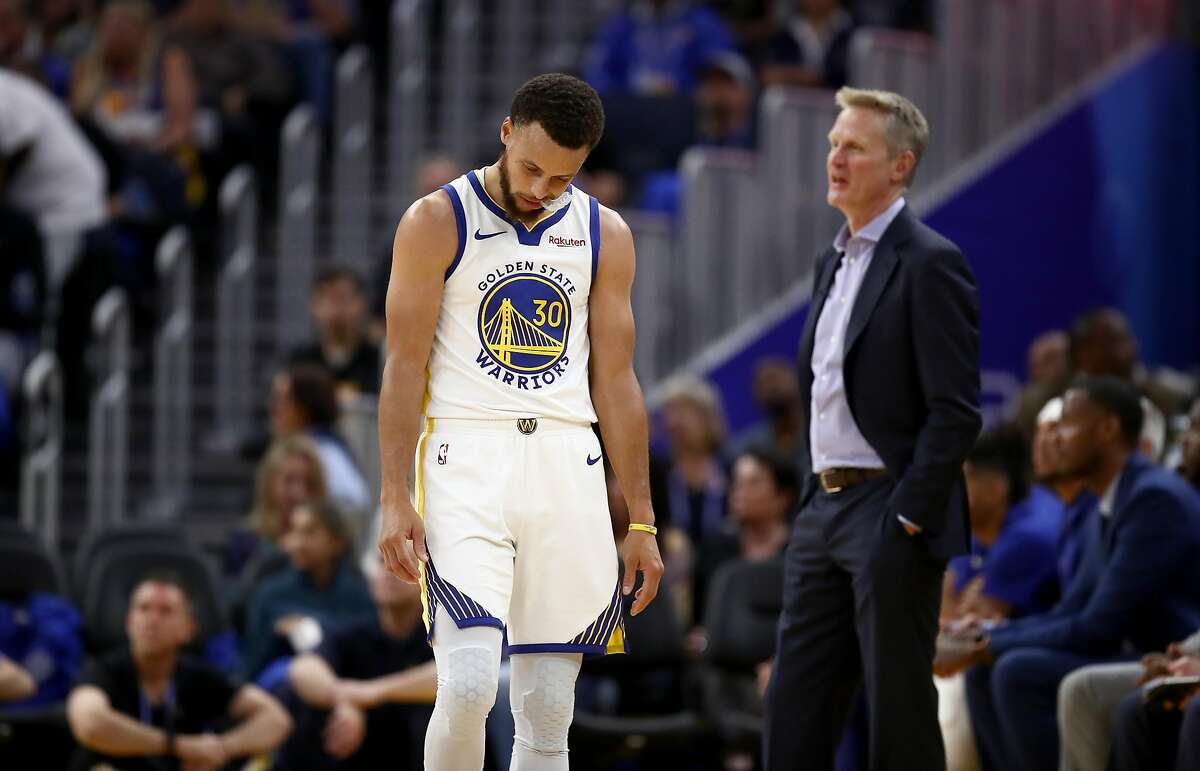 Stephen Curry #30 and head coach Steve Kerr of the Golden State Warriors react after a play during their game against the LA Clippers at Chase Center on October 24, 2019 in San Francisco, California.