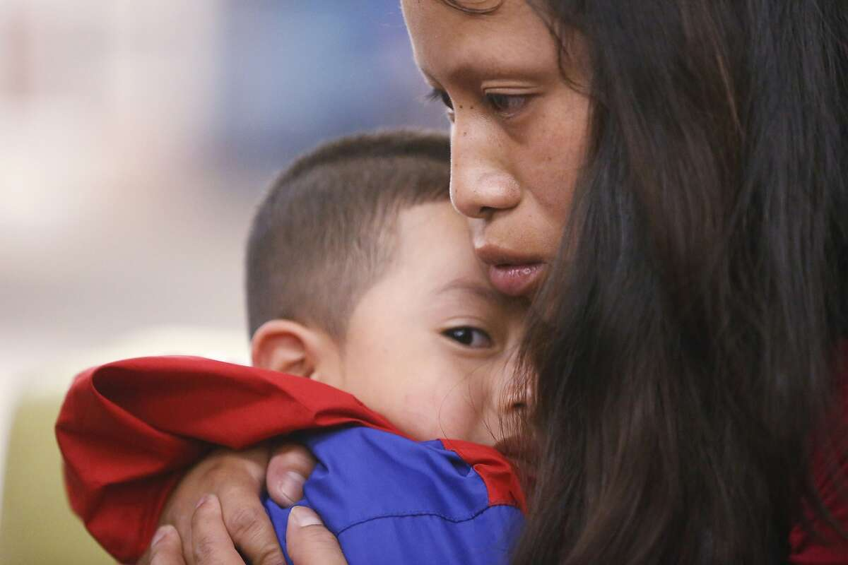 FILE - In this July 26, 2018, file photo, Maria holds her 4-year-old son Franco after he arrived at the El Paso International Airport in El Paso, Texas. The two had been separated for over six weeks after entering the country. U.S. immigration authorities separated more than 1,500 children from their parents at the Mexico border early in the Trump administration, the American Civil Liberties Union said Thursday, Oct. 24, 2019, bringing the total number of children separated since July 2017 to more than 5,400.