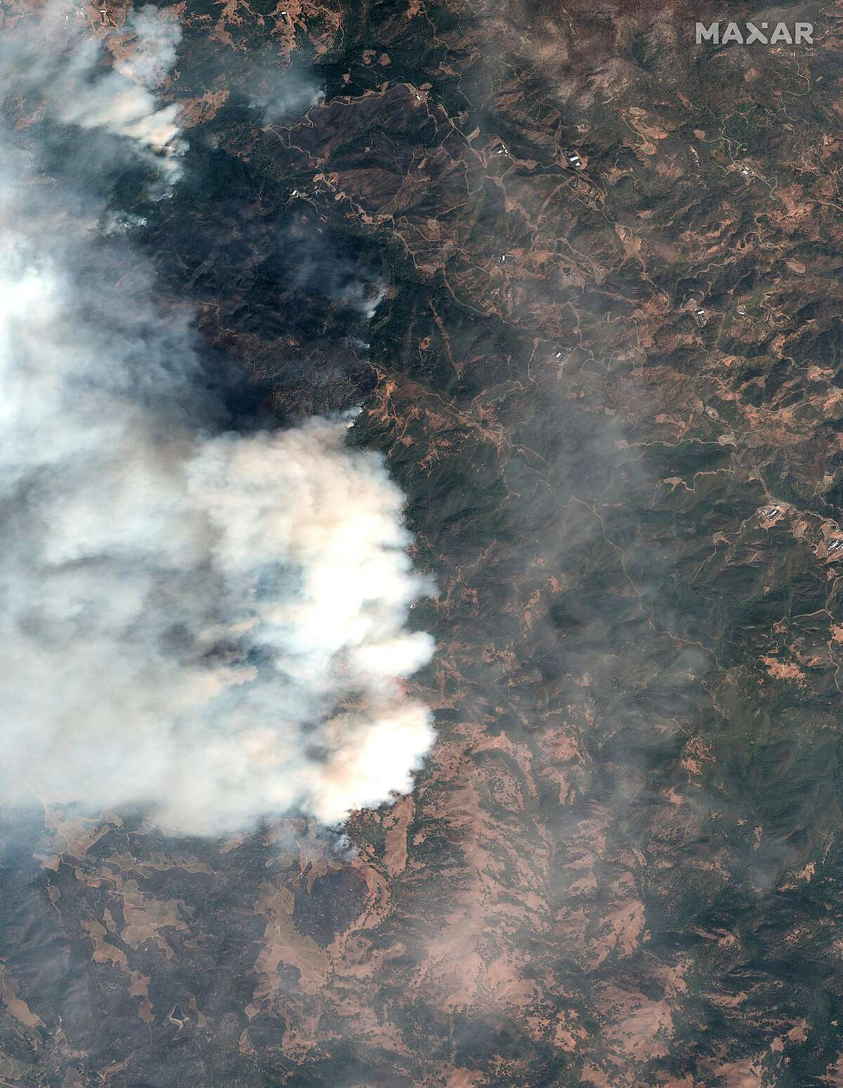 This satellite image provided by Maxar Technologies shows a wildfire burning in Sonoma County, Calif., on Thursday, Oct. 24, 2019. The fire that began Wednesday night in wine country has burned dozens of buildings and prompted evacuation orders in the Geyserville area.