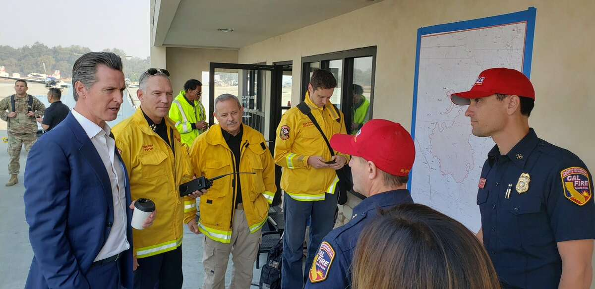 California Governor Gavin Newsom meets with Cal Fire Chief Thom Porter, second from left, California Office of Emergency Services Director Mark Ghilarducciwith, third from left, and other Cal Fire personnel in Sonoma County during the Kincade Fire response, Friday, Oct. 25, 2019.