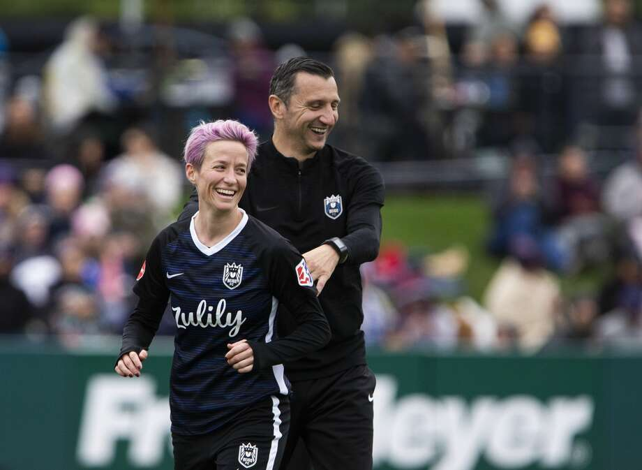 TACOMA, WA - SEPTEMBER 29:  Megan Rapinoe #15 of Reign FC smiles with Reign FC coach Vlatko Andonovski after being subbed out in the second half of the game at Cheney Stadium on September 29, 2019 in Tacoma, Washington. Reign FC won 2-0. (Photo by Lindsey Wasson/Getty Images) Photo: Lindsey Wasson/Getty Images