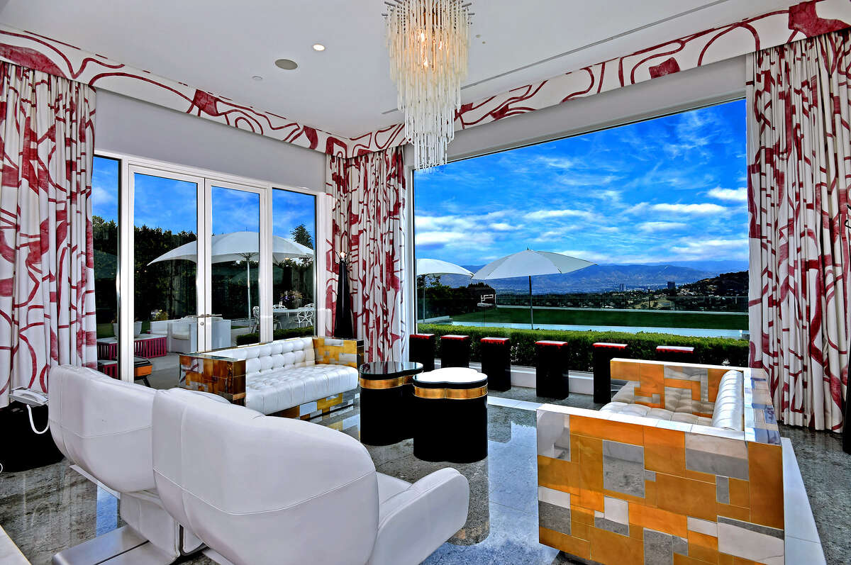 Singer Gwen Stefani sold her contemporary-style compound in the Beverly Hills Post Office area to stand-up comic Sebastian Maniscalco for $21.65 million. The 11,845-square-foot spread, which was once owned by Jennifer Lopez, features bold splashes of color, book-matched marble slabs and a black-and-white striped kitchen. The property sits on about two acres and has a swimming pool, a tennis court and a playground. At the far end of the property is a chicken coop. (James Moss)