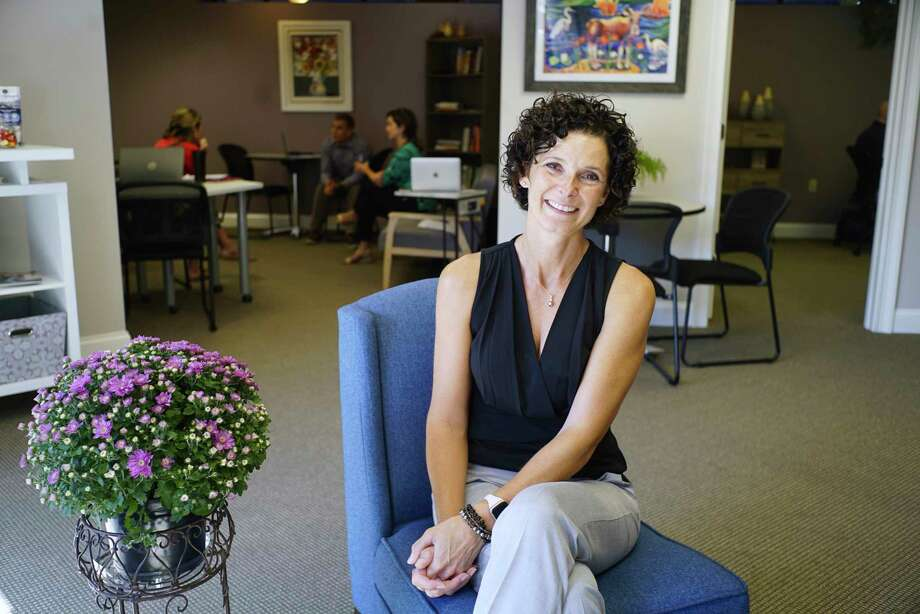 Christy Alexander, founder of coworking space WorkSmart, poses for a photo at her business on Wednesday, Sept. 25, 2019, in Glens Falls, N.Y.  (Paul Buckowski/Times Union) Photo: Paul Buckowski / (Paul Buckowski/Times Union)