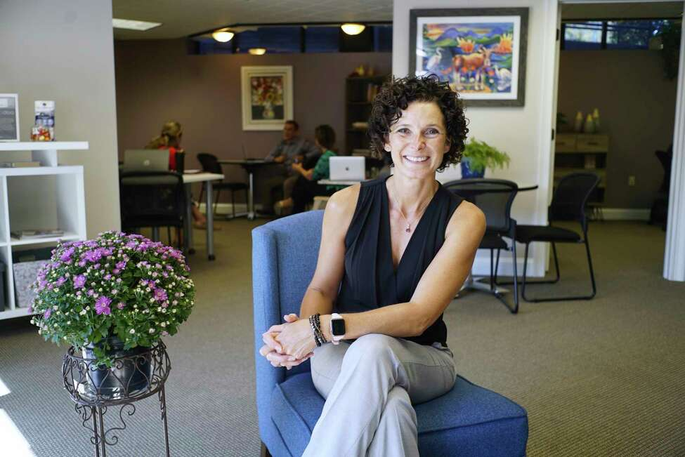 Christy Alexander, founder of coworking space WorkSmart, poses for a photo at her business on Wednesday, Sept. 25, 2019, in Glens Falls, N.Y. (Paul Buckowski/Times Union)