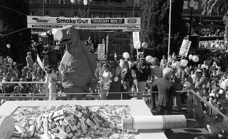 A 12-foot Godzilla leads the march onto the stage at the second annual Great American Smokeout on Nov. 16, 1977. Photo: Terry Schmitt / The Chronicle 1977