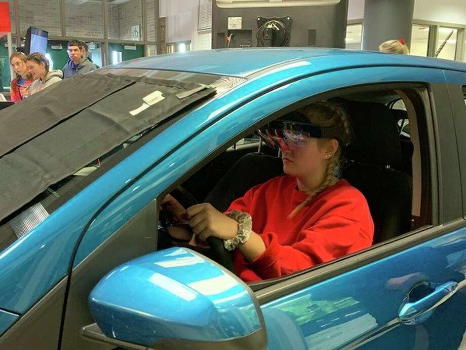 Laker senior Angel Stump tries out the simulated distracted driving experience, Many students were surprised that they were more likely to speed when they were distracted. (Submitted Photo)