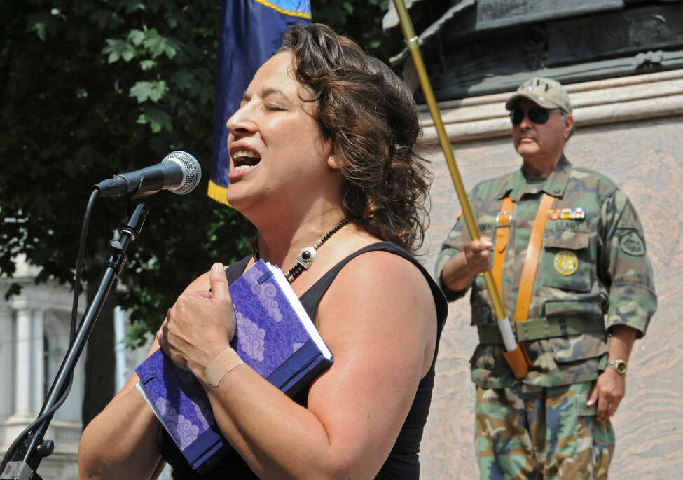 Caroline Isachsen a.k.a. Mother Judge sings The National Anthem during a Memorial Day ceremony held at Lafayette Park after the Albany Memorial Day Parade in Albany, N.Y. Monday May 30, 2011. a (Lori Van Buren / Times Union)