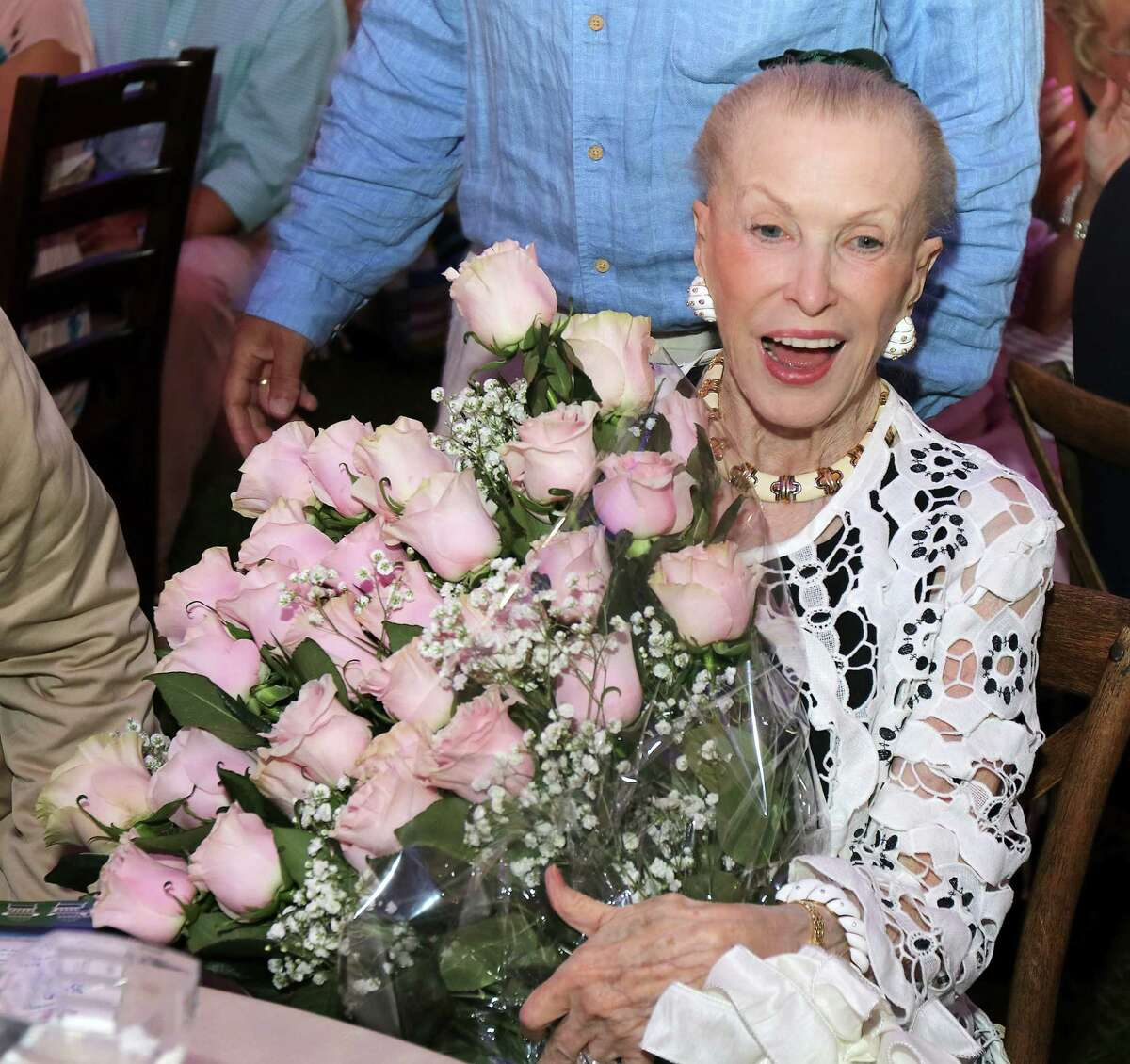 Saratoga Springs, NY - August 2, 2017 - (Photo by Joe Putrock/Special to the Times Union) - Philanthropist Marylou Whitney was presented with dozens of roses, each representing a year of support for Saratoga Hospital, during the Saratoga Hospital Foundationa€™s 35th Annual Summer Gala and Benefit Auction at Polo Meadows at the Saratoga Casino and Raceway. ORG XMIT: 09
