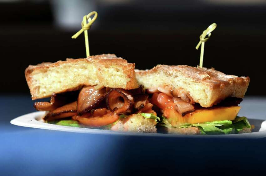 PBLT; crispy pork belly, spicy bbq sauce, lettuce and heirloom tomato is served at Bard & Baker on Tuesday, March 12, 2019, in Troy, N.Y. The board game cafe is located in the former Troy Record building. (Will Waldron/Times Union)