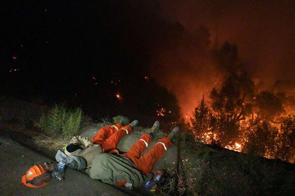 Pine Grove Youth Conservation Camp members rest Oct. 25 after two days fighting the Kincade Fire near the River Rock Casino in Geyserville.
