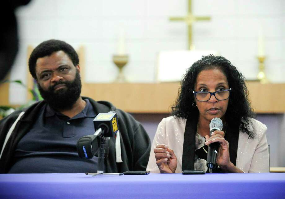 Steven Barrier Sr. sits next to Valerie Jaddo, mother of Steven Barrier, as she reads a prepared statement during a press conference at Bethel AME Church in Stamford on Oct. 25, 2019, regarding the incident with her son and the Stamford Police Department. Clergy, community leaders and the Stamford NAACP along with family members release of information into what happen. Photo: Matthew Brown / Hearst Connecticut Media / Stamford Advocate