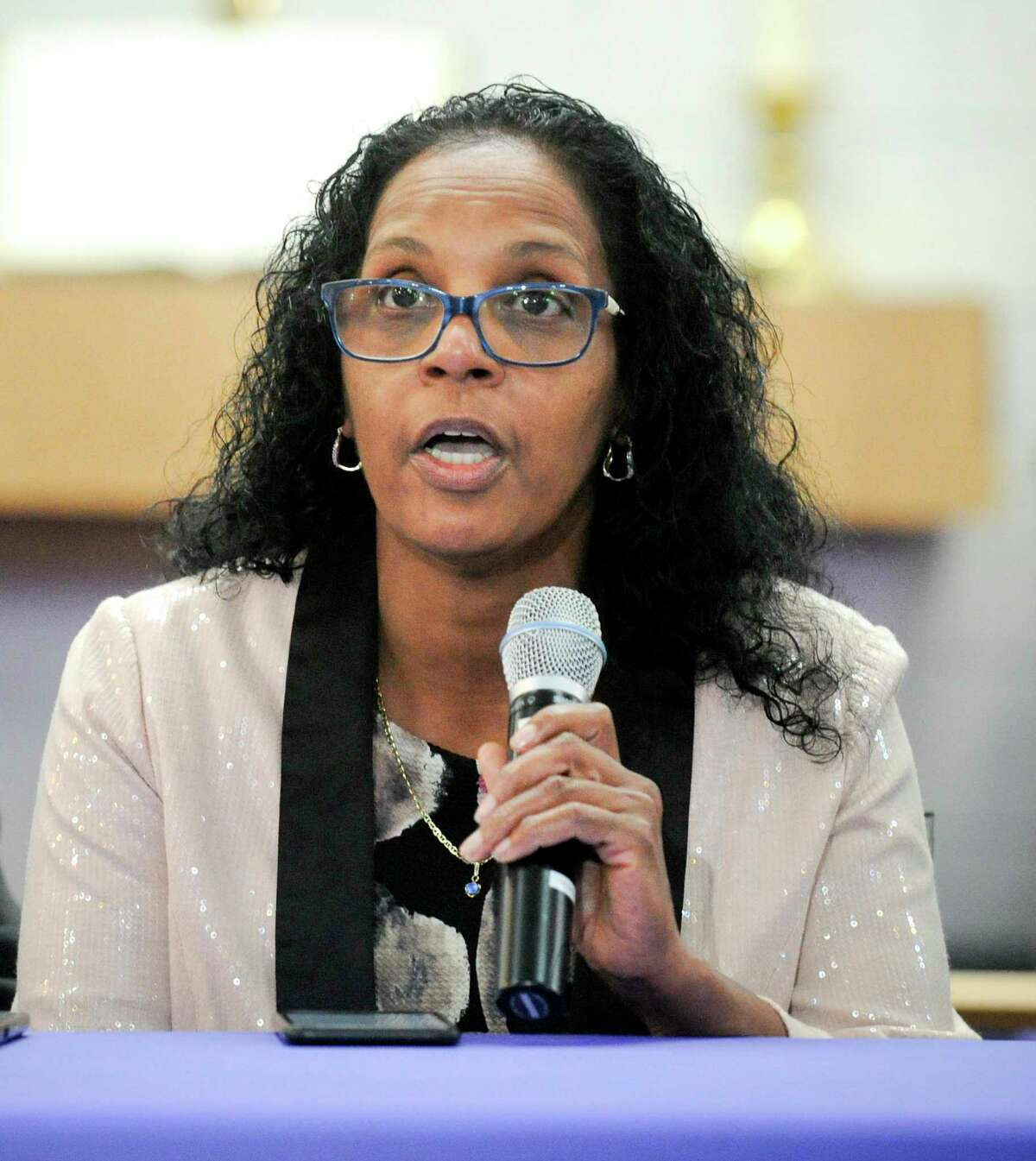 Valerie Jaddo, mother of Steven Barrier, reads a prepared statement during a press conference at Bethel AME Church in Stamford on Oct. 25, 2019, regarding the incident with her son and the Stamford Police Department. Clergy, community leaders and the Stamford NAACP along with family members release of information into what happen.