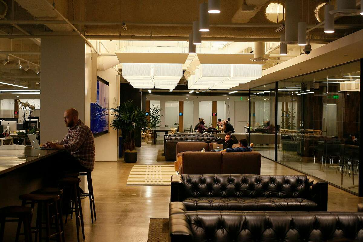Uber employees work away from their desks at their new office in San Francisco, Calif. on Friday, May 30, 2014. This is Uber's seventh move.