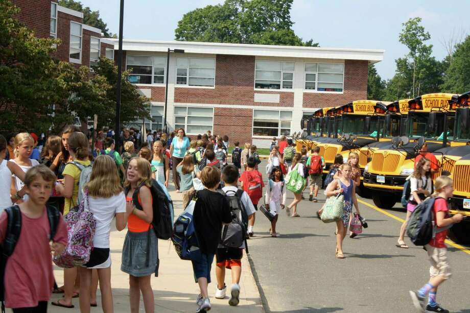 Students hurry to get on the buses at Saxe Middle School after completing their second day of school. Photo: Ben Holbrook / Contributed photo / ST Photo: Ben Holbrook Contributed Photo / ST / New Canaan News