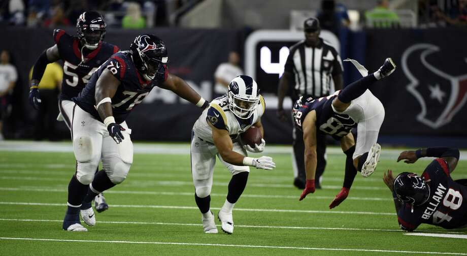 Los Angeles Rams running back Matt Colburn (37) rushes as Houston Texans' Javi Edwards (78) and Xavier Crawford (28) defend during the second half of a preseason NFL football game Thursday, Aug. 29, 2019, in Houston. (AP Photo/Eric Christian Smith) Photo: Eric Christian Smith/AP