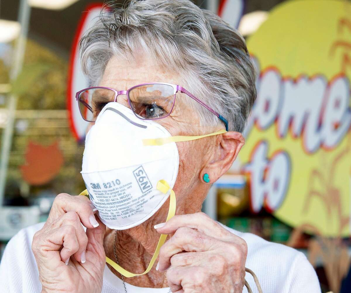 Dinah Mattos, 76, of Novato sports a respirator mask while purchasing more of them at Pini Ace Hardware in Novato, Calif. Friday, Oct. 25, 2019 in response to poor air quality due to smoke from the Kincade Fire in northern Sonoma County.