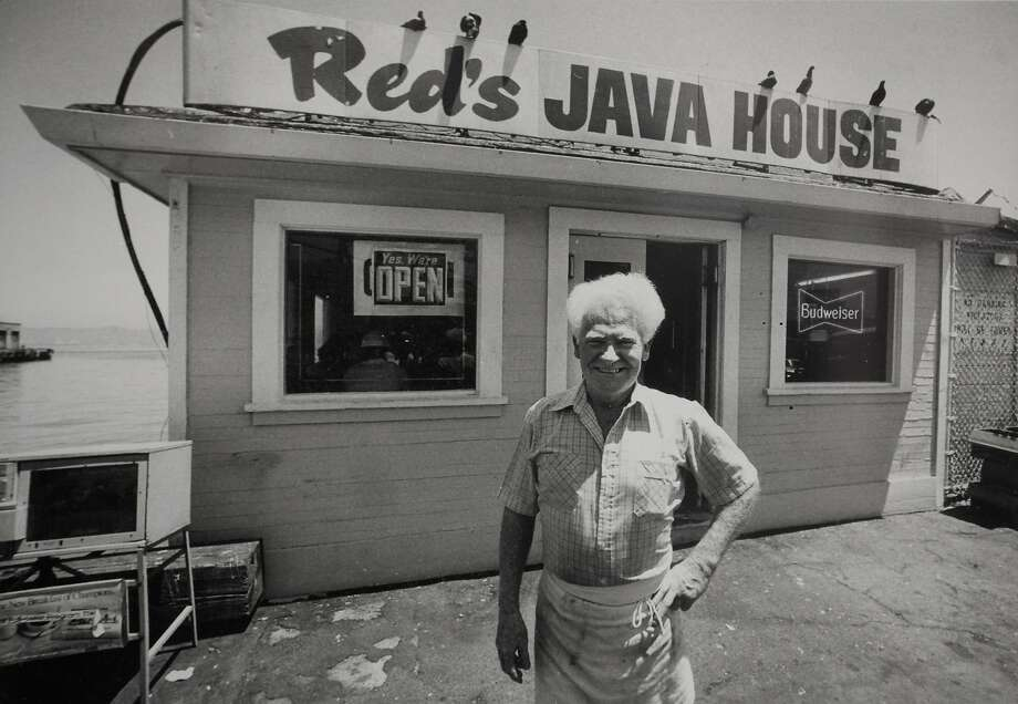 "Former owner of Red's Java House Tom ""Red"" McGarvey stands in front of the port side cafe during the latter years of ownership. Photo: Courtesy Tom McGarvey"