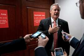 Rep. Mark Meadows (R-N.C.) speaks to reporters from the doorway of the secure area where impeachment investigation interviews are taking place on Capitol Hill in Washington, Oct. 23, 2019. House Republicans' move to occupy the secure chambers of the House Intelligence Committee may not have succeeded in shutting down Democrats' impeachment inquiry, but for a day at least, it shifted debate in the Capitol away from damaging testimony against President Donald Trump to questions about how the inquiry itself is being conducted. (Erin Schaff/The New York Times)