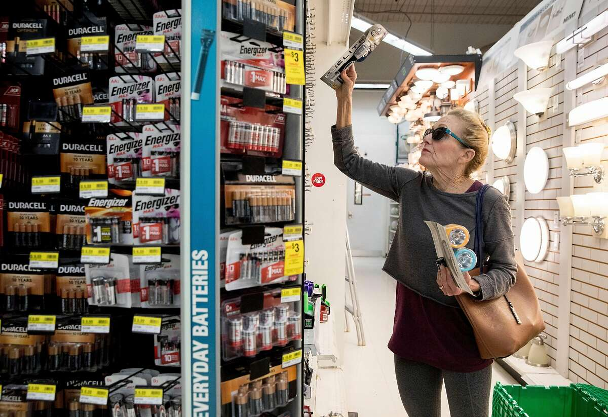 Deborah Kennard of Novato shops for batteries and flashlights at Ace Hardware in Novato, Calif. Friday, Oct. 25, 2019 in response to an upcoming PG&E Public Safety Power Outage affecting all of Marin County.