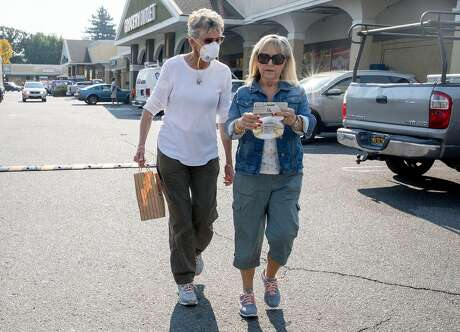Dinah Mattos, 76, of Novato (left) sports a respirator mask while walking with Susan Blow of Penngrove after purchasing more masks at Pini Ace Hardware in Novato, Calif. Friday, Oct. 25, 2019 in response to poor air quality due to smoke from the Kincade Fire in northern Sonoma County. Photo: Jessica Christian / The Chronicle